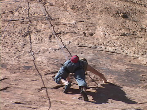A rock climber scales a wall Footage