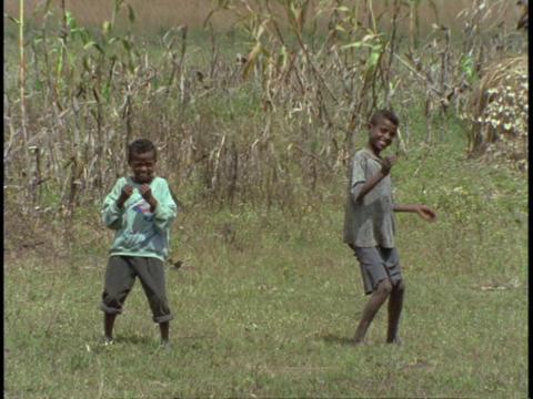 boys dance in a grassy field Stock Video Footage