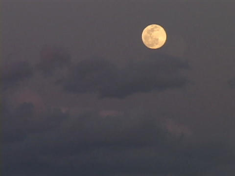The moon rises in the sky Stock Video Footage