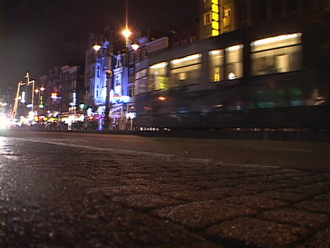A trolley drives through Amsterdam Stock Video Footage