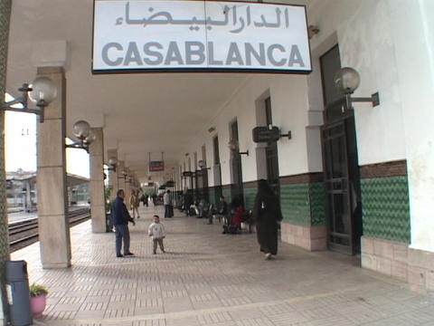 Pedestrians pass under the Casablanca train station sign Footage