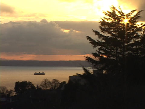 A ferry boat cruises on Puget Sound in Seattle, Washington Footage
