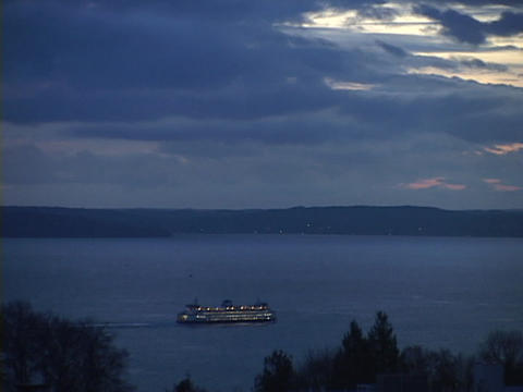 A ferryboat leaves the Seattle harbor Footage