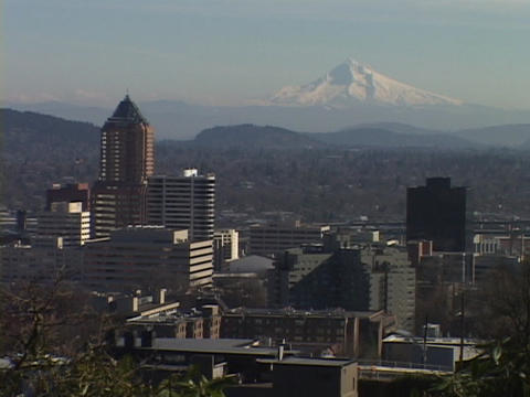 Mount Hood stands behind the Portland skyline Stock Video Footage