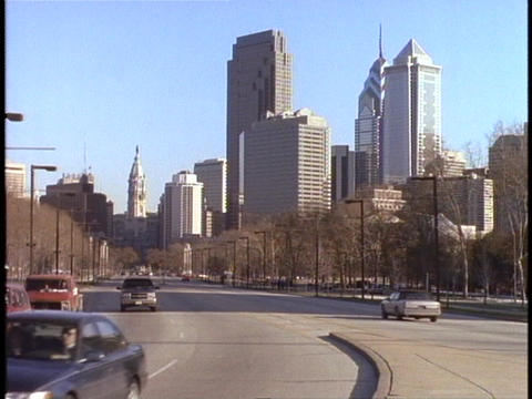 Cars drive past the Philadelphia skyline Stock Video Footage