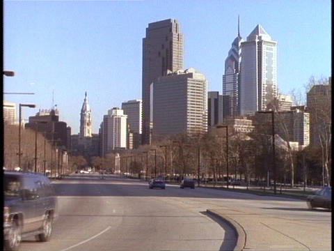Cars drive past the Philadelphia skyline Footage