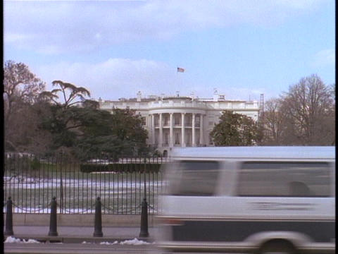 Snow covers the grounds of the United States White House Stock Video Footage