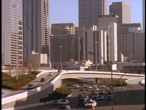 Skyscrapers tower over an Atlanta freeway Footage