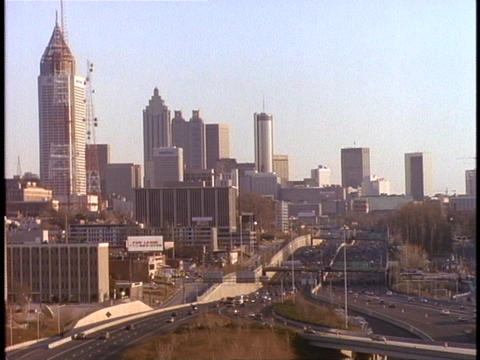 Skyscrapers rise above a freeway in Atlanta Footage