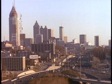 Skyscrapers rise above a freeway in Atlanta Stock Video Footage