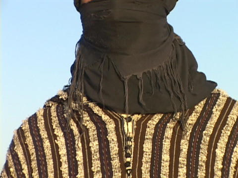 The eyes of an Arab man show through his burka Footage