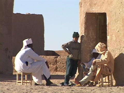 A Sudanese family sits outside their home in the village Stock Video Footage