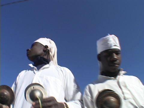A group of Sudanese men in kaftans play cymbal-like... Stock Video Footage