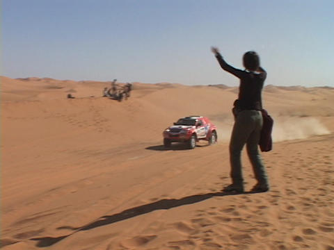 A spectator cheers as a rally car races by Stock Video Footage
