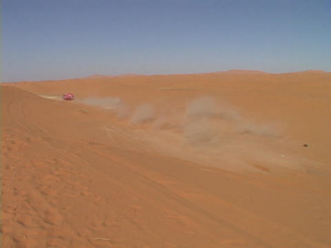 A rally car leaves a trail of dust as it speeds out of sight Stock Video Footage