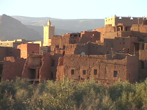 Adobe buildings crowd close together on a hillside Stock Video Footage
