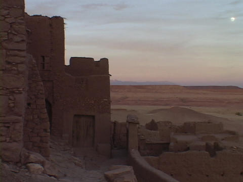 Stone walls surround a village in the Moroccan desert Stock Video Footage