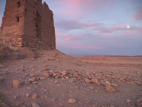 A carved stone building rises above the desert Stock Video Footage