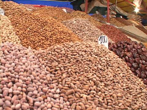 Beans and other foods fill a stall at a market in... Stock Video Footage
