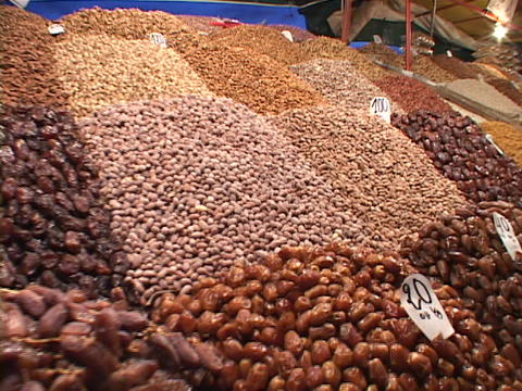 Beans and other foods fill a stall at a market in Marrakesh Morocco Footage
