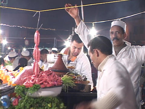 Chefs happily cheer and clap as they cook on a busy street Stock Video Footage
