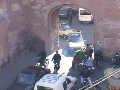 way traffic struggles to fit through a small tunnel on a... Stock Video Footage
