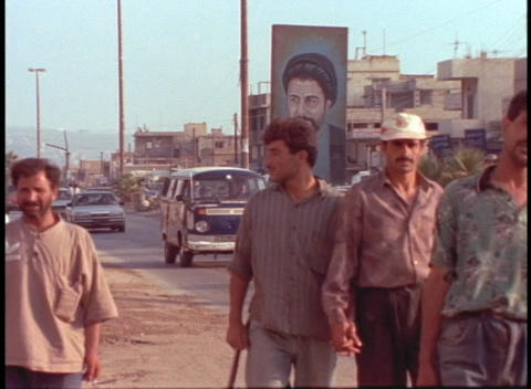 Muslim workers walk home along a South Lebanon street Stock Video Footage