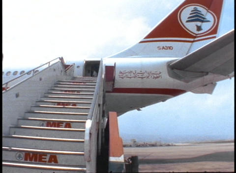 A Passenger Climbs The Stairs To Board A Middle East Airlines Airbus In Beirut, Lebanon stock footage