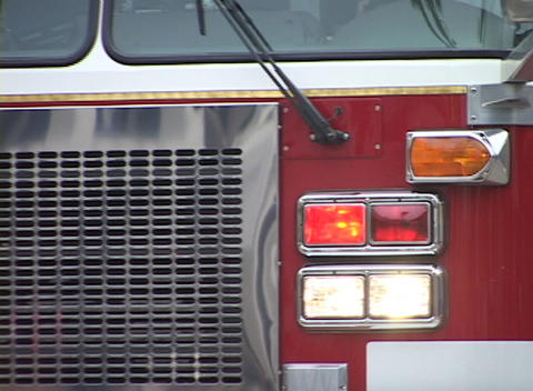 A fire truck heads down the street with emergency lights... Stock Video Footage