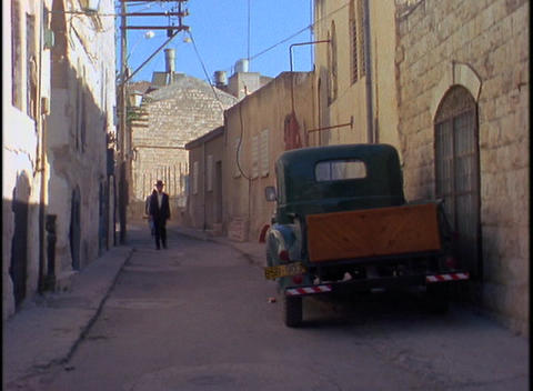An Orthodox Jew walks through a traditional neighborhood... Stock Video Footage