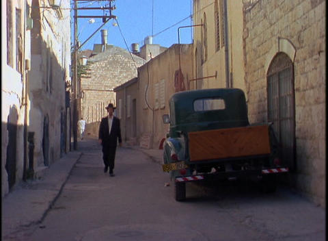 An Orthodox Jew walks through a traditional neighborhood in Israel Footage