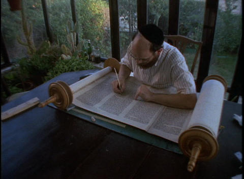 An Orthodox Jewish scribe works on writing a Torah scroll Stock Video Footage