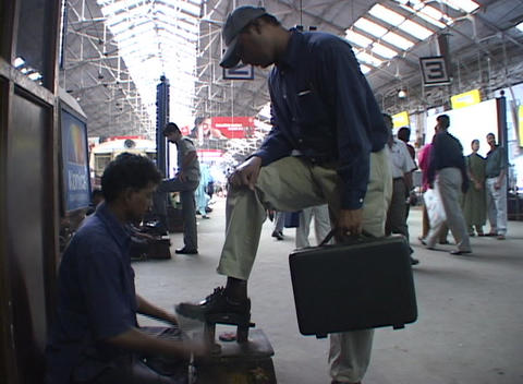 People exit a commuter train at Bombay's Victoria station... Stock Video Footage