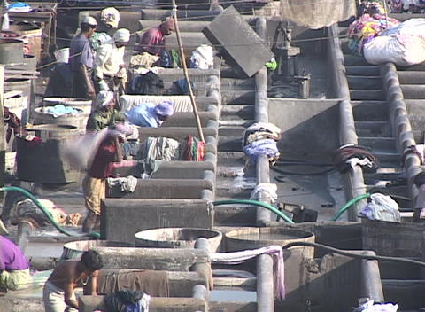 People wash clothes at the dhobi gnats, open air laundries, in Bombay India Footage