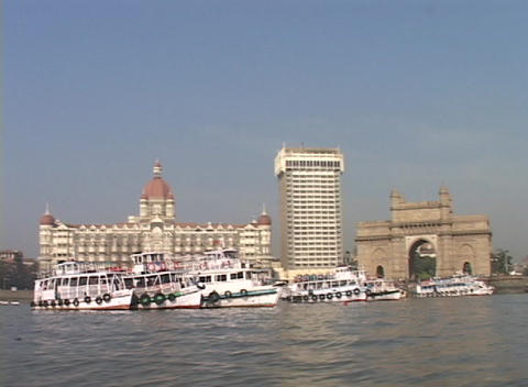 A point of view from a small boat entering the harbor in Bombay, India with the Taj Mahal Hotel and Footage