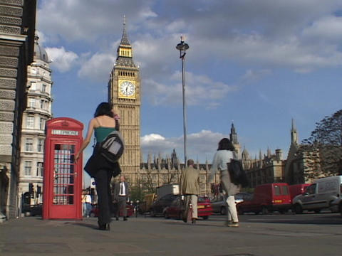 London traffic and pedestrians pass by Big Ben and the Parliament building Footage