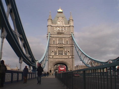 London traffic and pedestrians travel over the London Bridge Stock Video Footage