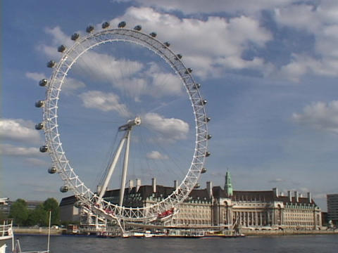 The London Eye ferries wheel stands high above the River Thames in London, England Live Action