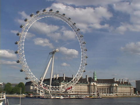 The London Eye ferries wheel stands high above the River... Stock Video Footage