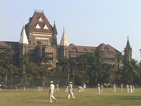 Cricket players practice in front of a Victorian... Stock Video Footage