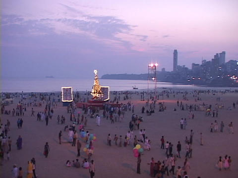 A Christmas tree lights up a beach in Mumbai Stock Video Footage