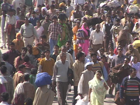A mass of pedestrians walks down a street in India Stock Video Footage