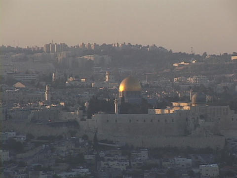 The gold Dome of the Rock glows in the middle distance in... Stock Video Footage