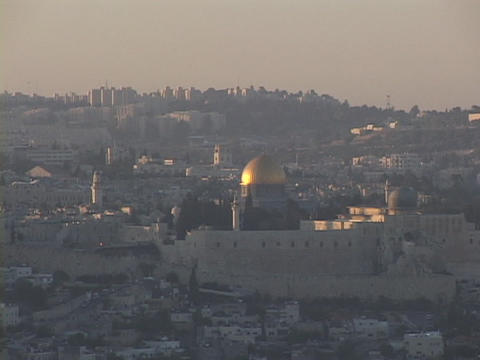 The gold Dome of the Rock glows in the middle distance in the Old City, Jerusalem Footage