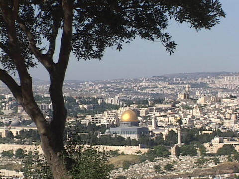 Jerusalem, with the prominent Dome of the Rock, stretches to the horizon from a Mt. Olive view Live Action