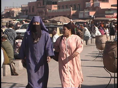 Pedestrians walk down the street in Marrakesh, Morocco Footage