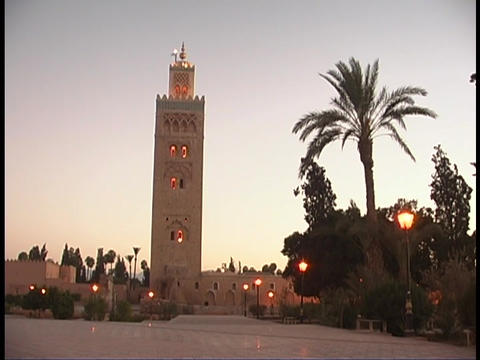 A Mosque towers over the city of Marrakesh, Morocco Stock Video Footage