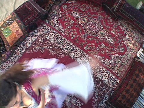 A belly dancer wears traditional a costume and performs a... Stock Video Footage