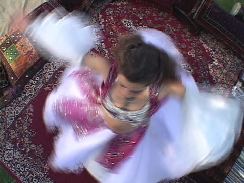 A belly dancer wears traditional a costume and performs a belly dance Live Action