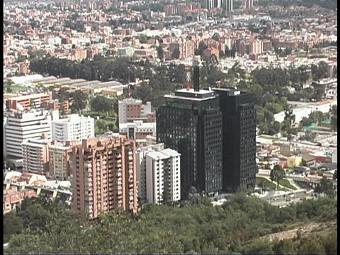 Skyscrapers rise above the city of Bogota, Colombia Stock Video Footage